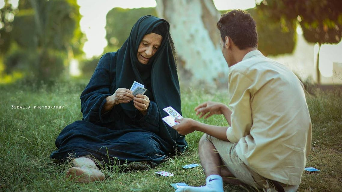 Egyptian grandmother and grandson playing cards in the park. (Courtesy: 3BDALLA PGOTOGRAPHY)