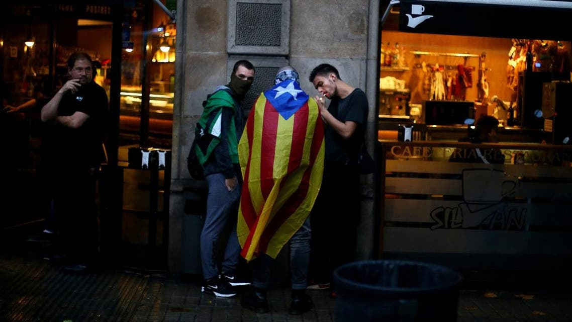 A demonstrator wears an Estelada during a gathering to protest against the imprisonment of the leaders of two of the largest Catalan separatist organisations, in Barcelona. (Reuters)