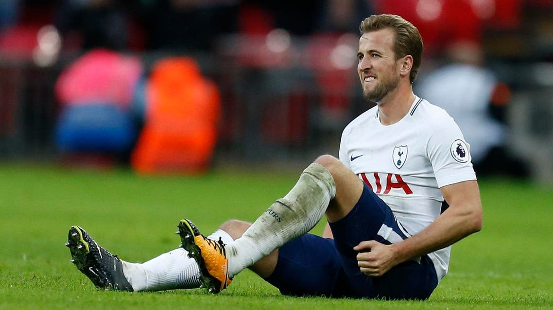 Tottenham Hotspur's English striker Harry Kane holds his leg after appearing to pick up an injury during the English Premier League football match between Tottenham Hotspur and Liverpool at Wembley Stadium in London, on October 22, 2017.