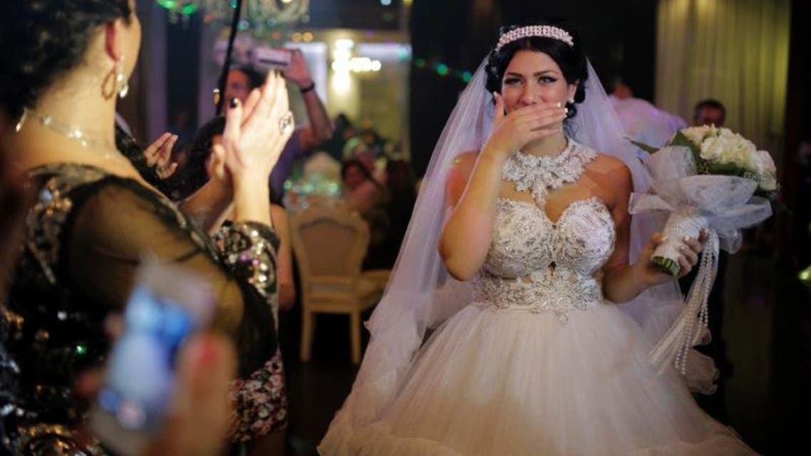 Israeli bride Morel Malcha (C) walked down the isle with Israeli Arab groom Mahmud Mansur in August 2014 to racist chants by extremists opposed to the marriage of a Jew and a Muslim (AFP Photo/Daniel Bar-On)