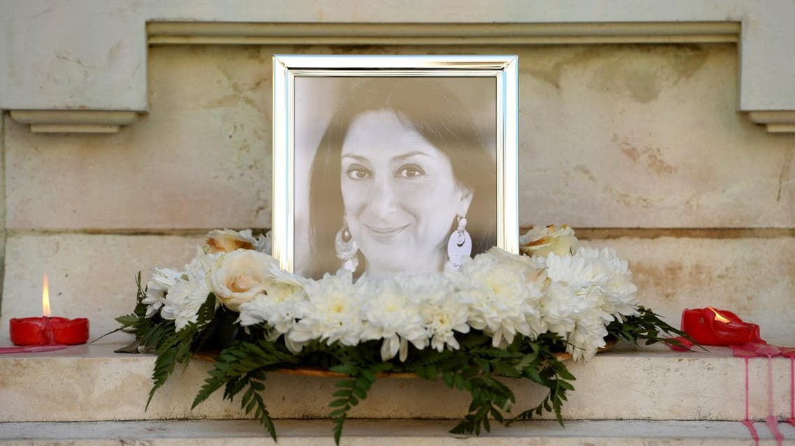 Flowers and tributes lay at the foot of the Great Siege monument in Valletta, Malta, on October 19, 2017 which has been turned into a temporary shrine for Maltese journalist and blogger Daphne Caruana Galizia (picture) who was killed by a car bomb outside her home in Bidnjia, Malta, on October 16, 2017. (AFP)