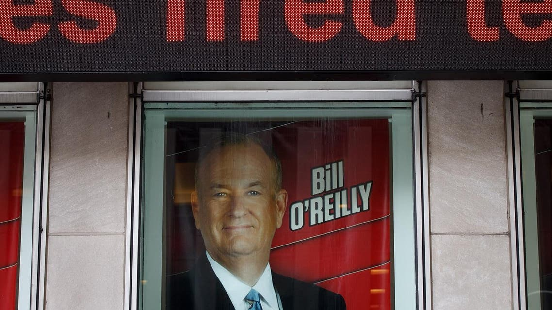NEW YORK, NY - APRIL 19: Advertisements for Fox News and Bill O'Reilly stand in a window outside of the News Corp. and Fox News headquarters in Midtown Manhattan, April 19, 2017 in New York City. 21st Century Fox, the parent company of Fox News, announced on Wednesday that Fox News television personality Bill O'Reilly will not be returning to the network following numerous claims of sexual harassment and subsequent legal settlements. Drew Angerer/Getty Images/AFP