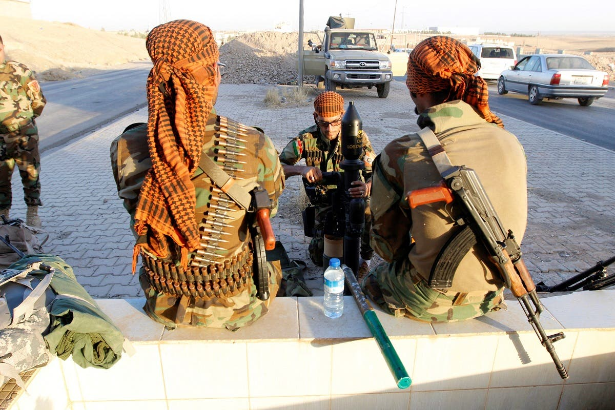 Kurdish Peshmerga fighters gather north of Kirkuk, Iraq October 19, 2017. (Reuters)