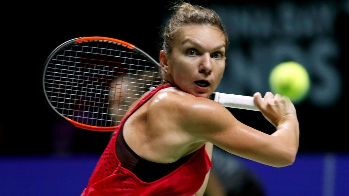 Romania's Simona Halep in action during her group stage match with France's Caroline Garcia. (Reuters)