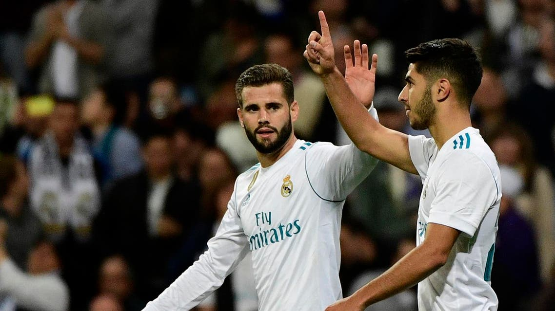 Real Madrid's Spanish midfielder Marco Asensio (R) celebrates with Real Madrid's Spanish defender Nacho Fernandez after scoring a goal during the Spanish league football match Real Madrid CF vs SD Eibar at the Santiago Bernabeu stadium in Madrid on October 22, 2017. ( AFP)