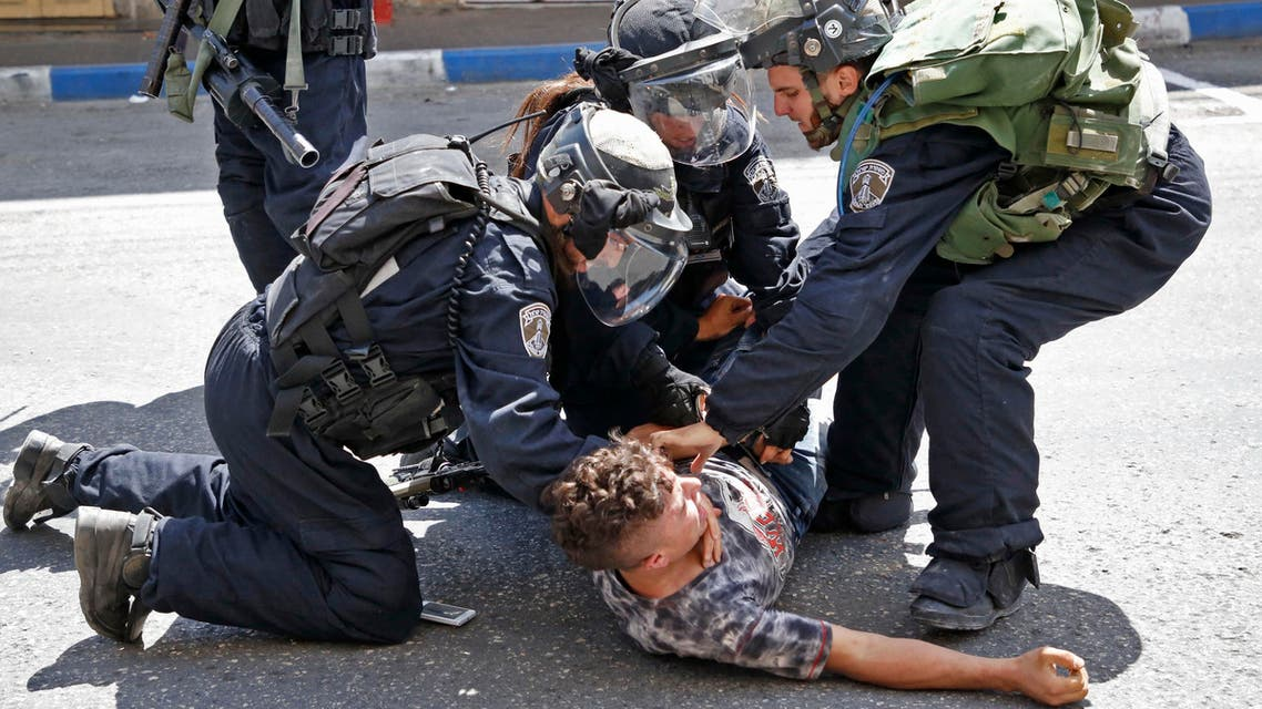 sraeli forces arrest a Palestinian youth during clashes between demonstrators and security forces in the city of Hebron in the Israeli-occupied West Bank, on July 28, 2017, as protests erupt in support of the Al-Aqsa mosque compound after Israeli police barred men under 50 from Friday prayers in the Old City of Jerusalem. Palestinians held mass prayers outside of a sensitive Jerusalem holy site after Israeli police barred men under 50 from entering following two weeks of tensions and deadly unrest. Despite fears of violent clashes around the Haram al-Sharif compound, known to Jews as the Temple Mount, the area was largely calm following Friday's midday prayers.  HAZEM BADER / AFP