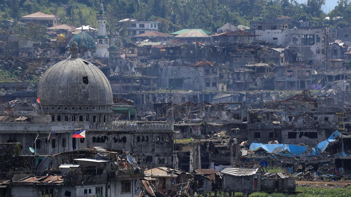 Damaged buildings beside a mosque are seen after government troops cleared the area from pro-ISIS militants inside a war-torn area in Marawi city. (Reuters)