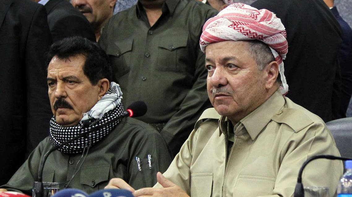 """A file picture taken on September 12, 2017 shows Iraq's Kurdistan region president Massud Barzani (R) attending an assembly with Kosrat Rasoul Ali (L), the first Deputy for the Secretary General of the Patriotic Union of Kurdistan (PUK) party, and other representatives of the Peshmerga and Arab, Kurdish, and Iraqi Turkmen tribal leaders in the northern Iraqi city of Kirkuk. A Baghdad court on October 19, 2017, issued an arrest warrant for the vice president of Iraqi Kurdistan, Kosrat Rasul, on charges of """"provocation"""" against Iraq's armed forces, the judiciary said. A(FP)"""