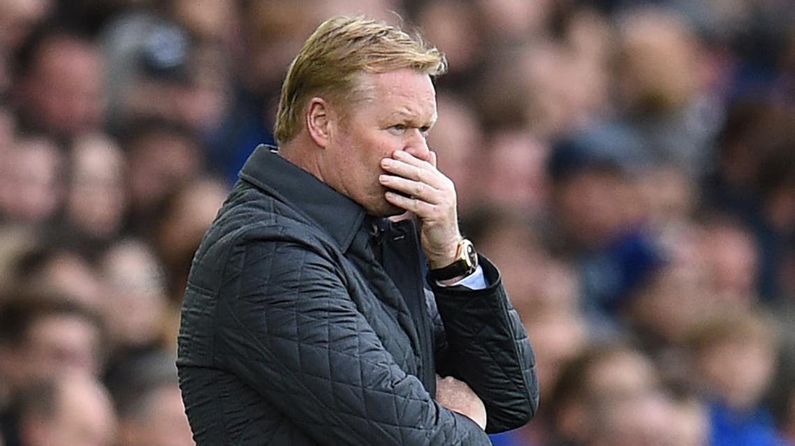(FILES) This file photo taken on October 22, 2017 shows Everton's Dutch manager Ronald Koeman reacting on the touchline shortly after Arsenal scored their second goal during the English Premier League football match between Everton and Arsenal at Goodison Park in Liverpool, north west England. Ronald Koeman became the third Premier League managerial casualty of the season on Monday, October 23, 2017 when he was sacked by Everton. (AFP)