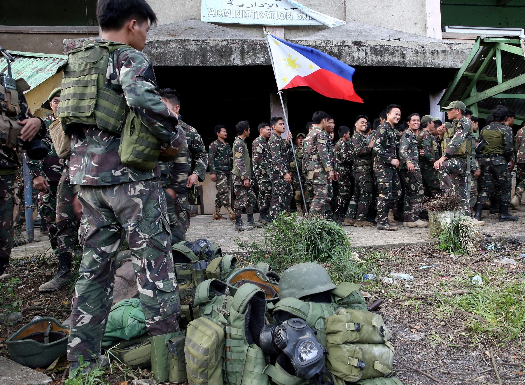 The Philippine flag is held by a soldier in Bangolo town, Marawi City. (Reuters)