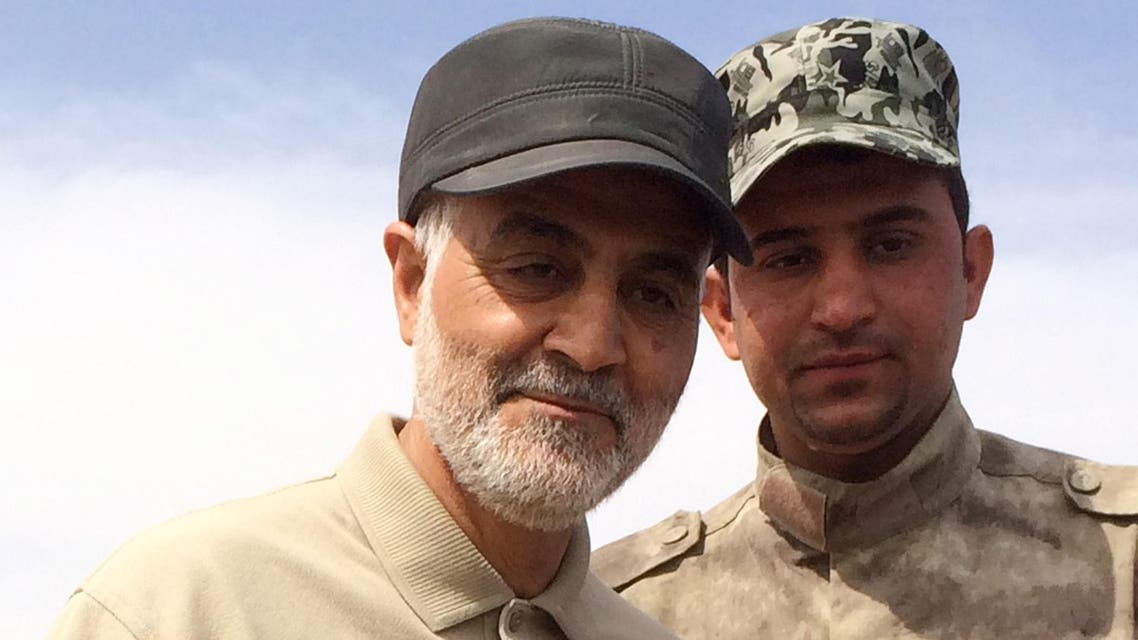 FILE PHOTO: Iranian Revolutionary Guard Commander Qassem Soleimani (L) stands at the frontline during offensive operations against Islamic State militants in the town of Tal Ksaiba in Salahuddin province March 8, 2015. (Reuters)