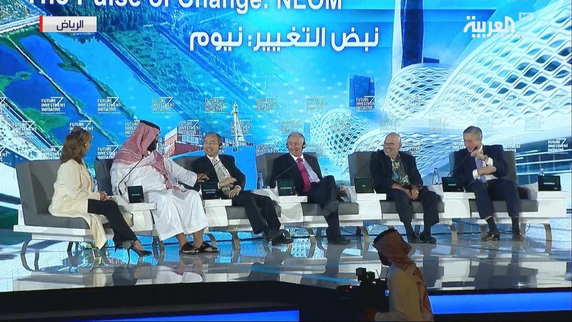 THUMBNAIL_ ولي العهد السعودي يصحح لرئيس سوفت بنك