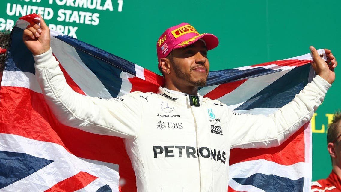 AUSTIN, TX - OCTOBER 22: Race winner Lewis Hamilton of Great Britain and Mercedes GP celebrates on the podium during the United States Formula One Grand Prix at Circuit of The Americas on October 22, 2017 in Austin, Texas. Clive Rose/Getty Images/AFP