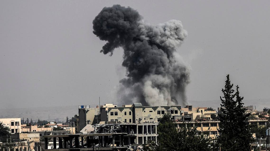 Heavy smoke billows following an airstrike on the western frontline of Raqa on July 17, 2017, during an offensive by the US-backed Syrian Democratic Forces, a majority Kurdish and Arab alliance, to retake the city from Islamic State (IS) group fighters. Heavy bombardment and fierce fighting shook the Islamic State group's Syrian stronghold Raqa, as SDF said they captured a new neighbourhood from entrenched jihadists. Bursts of gunfire and artillery as well as the thud of air strikes conducted by the US-led coalition filled the air in western neighbourhoods of Raqa, on what AFP's correspondent said was the heaviest day of bombardment to date. (AFP)