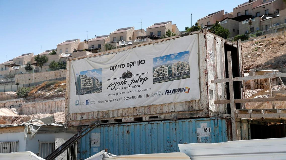 A general view taken on July 4, 2017 shows a poster advertising a new construction project in the Israeli settlement of west Gilo on the outskirts of Jerusalem. (AFP)