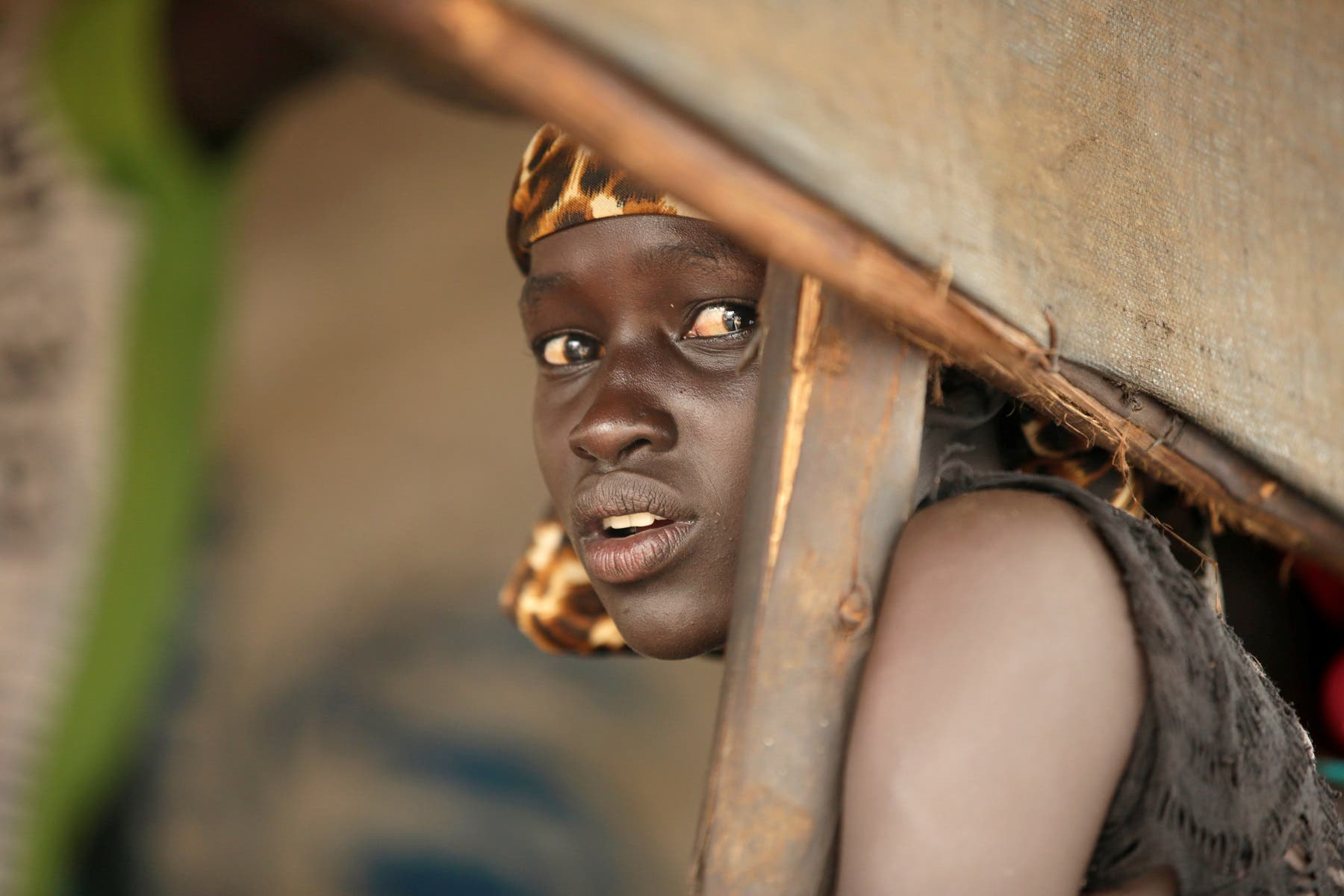 A South Sudanese refugee girl is seen at the Nguenyyiel refugee camp during a visit by US Ambassador to the United Nations Nikki Haley. (Reuters)