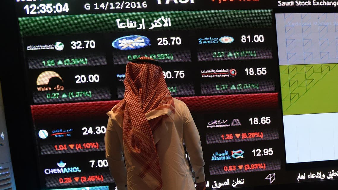 A Saudi investor monitors the stock exchange at the Saudi Stock Exchange, or Tadawul, on December 14, 2016 in the capital Riyadh. FAYEZ NURELDINE / AFP