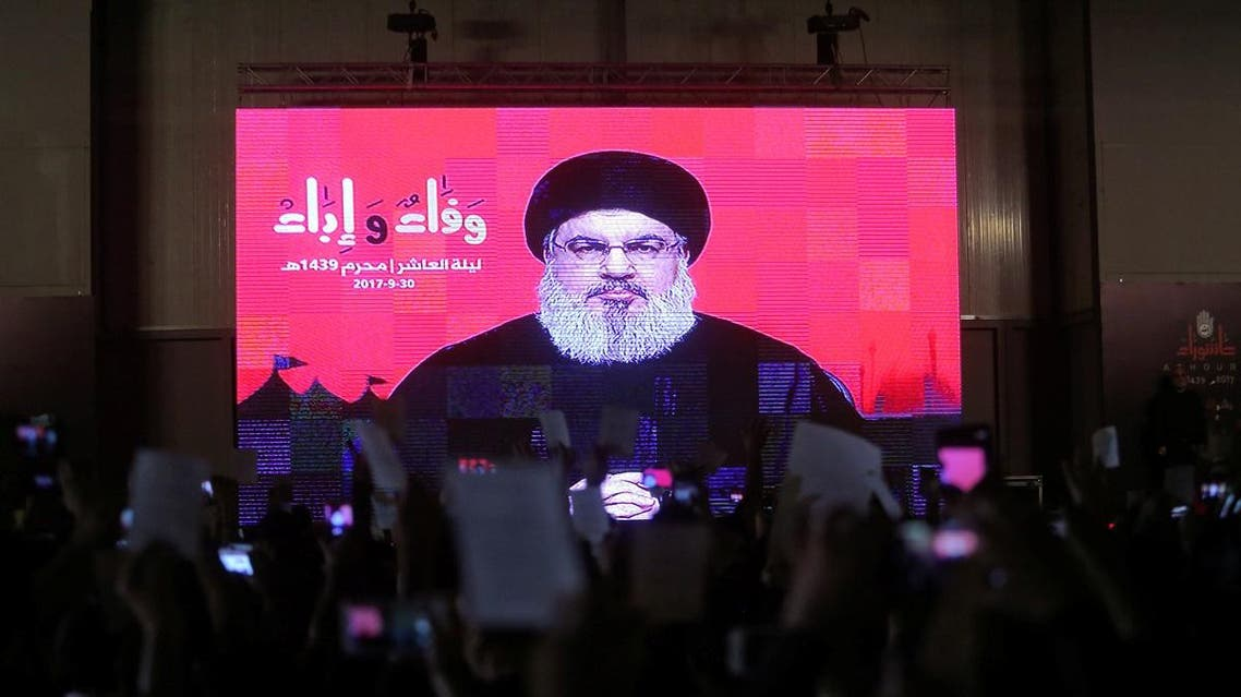 Lebanon's Hezbollah leader Sayyed Hassan Nasrallah is seen on a video screen as he addresses his supporters during a ceremony of the latest day of Ashoura in Beirut. (Reuters)