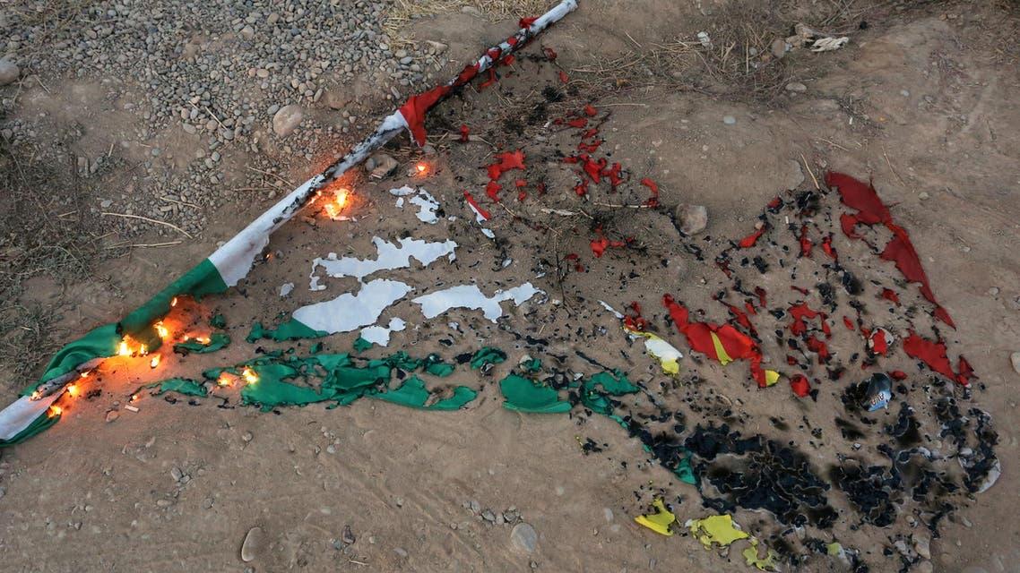 A burnt Kurdistan flag is seen in Kirkuk, Iraq October 16, 2017. REUTERS