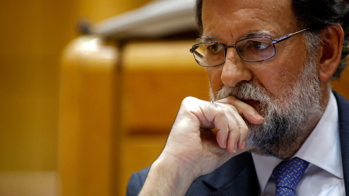 Spain's Prime Minister Mariano Rajoy attends a session of the Upper House of Parliament in Madrid on October 27, 2017. The central government has invoked the never-before-used article 155 of the Constitution, designed to rein in rebel regions, as it seeks to end Catalonia's drive to break from Spain. Spain's upper house is in charge of approving or rejecting the power seizure of the semi-autonomous Catalonia region proposed by Madrid.   OSCAR DEL POZO / AFP