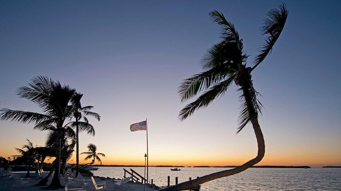 sunset behind Pierre's Restaurant in Islamorada, Fla. Following Hurricane Irma's Sept. (AFP)