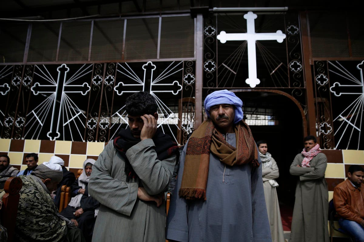 Men mourn over the Egyptian Coptic Christians who were captured in Libya and killed by militants affiliated with ISIS, at the Virgin Mary church in the village of el-Aour, near Minya. (File photo: AP)