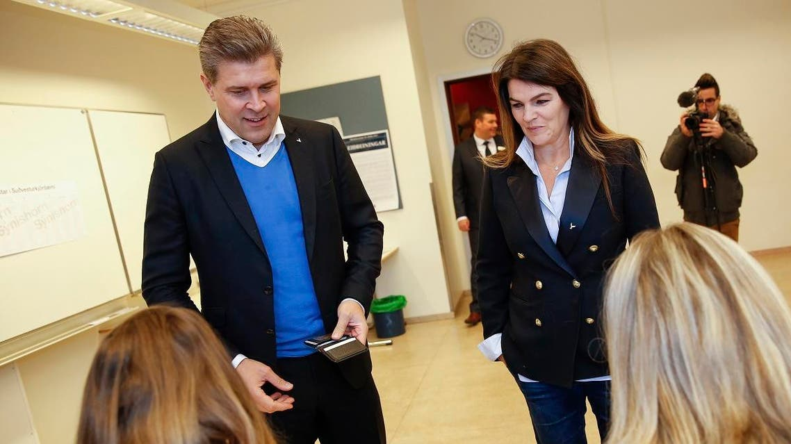 Bjarni Benediktsson, Prime Minister of Iceland, and leader of the Independence Party and his wife Thora Margret Baldvinsdottir cast their ballots during the general election in Gardabaer, Iceland, Saturday Oct. 28, 2017. (AP)