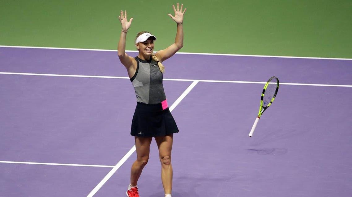 Caroline Wozniacki celebrates winning the final against USA's Venus Williams. (Reuters)
