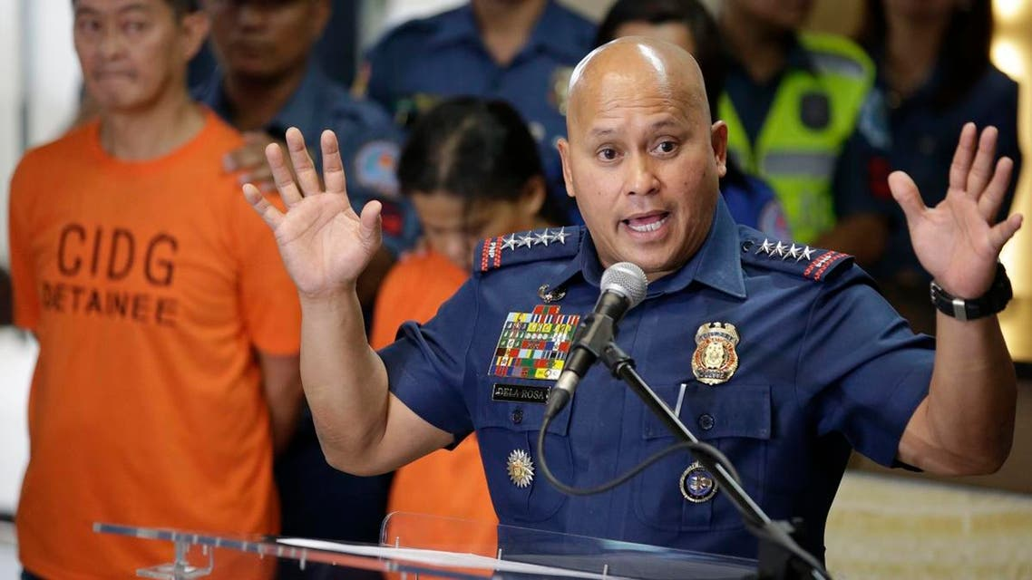 Philippine National Police Chief Director General Ronald Dela Rosa, right, gestures as he talks to reporters at police headquarters in metropolitan Manila, Philippines on Tuesday, Oct. 24, 2017. (AP)