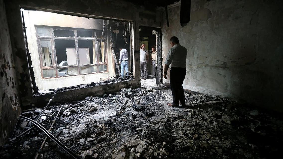 An interior view of the Patriotic Union of Kurdistan (PUK) building is seen after it was burnt overnight, in the town of Zakho. (Reuters)