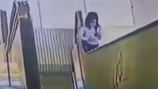 WATCH: Girl's shirt gets trapped in escalator and gets dragged up