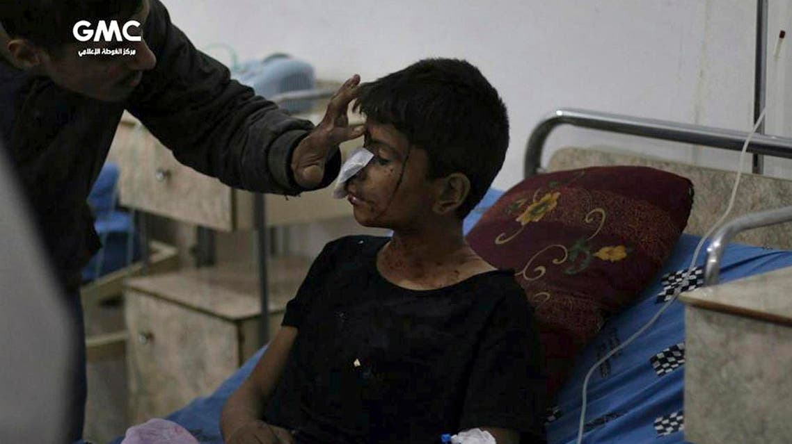 In this photo provided by the Syrian anti-government activist group, Ghouta Media Center, GMC, which has been authenticated based on its contents and other AP reporting, shows an injured boy receiving treatment at a hospital in Ghouta, an opposition-controlled suburb of Damascus, Syria, Tuesday, Oct. 31, 2017. GMC said Tuesday that several children were killed when government shelling hit their school in Ghouta. (Ghouta Media Center via AP)