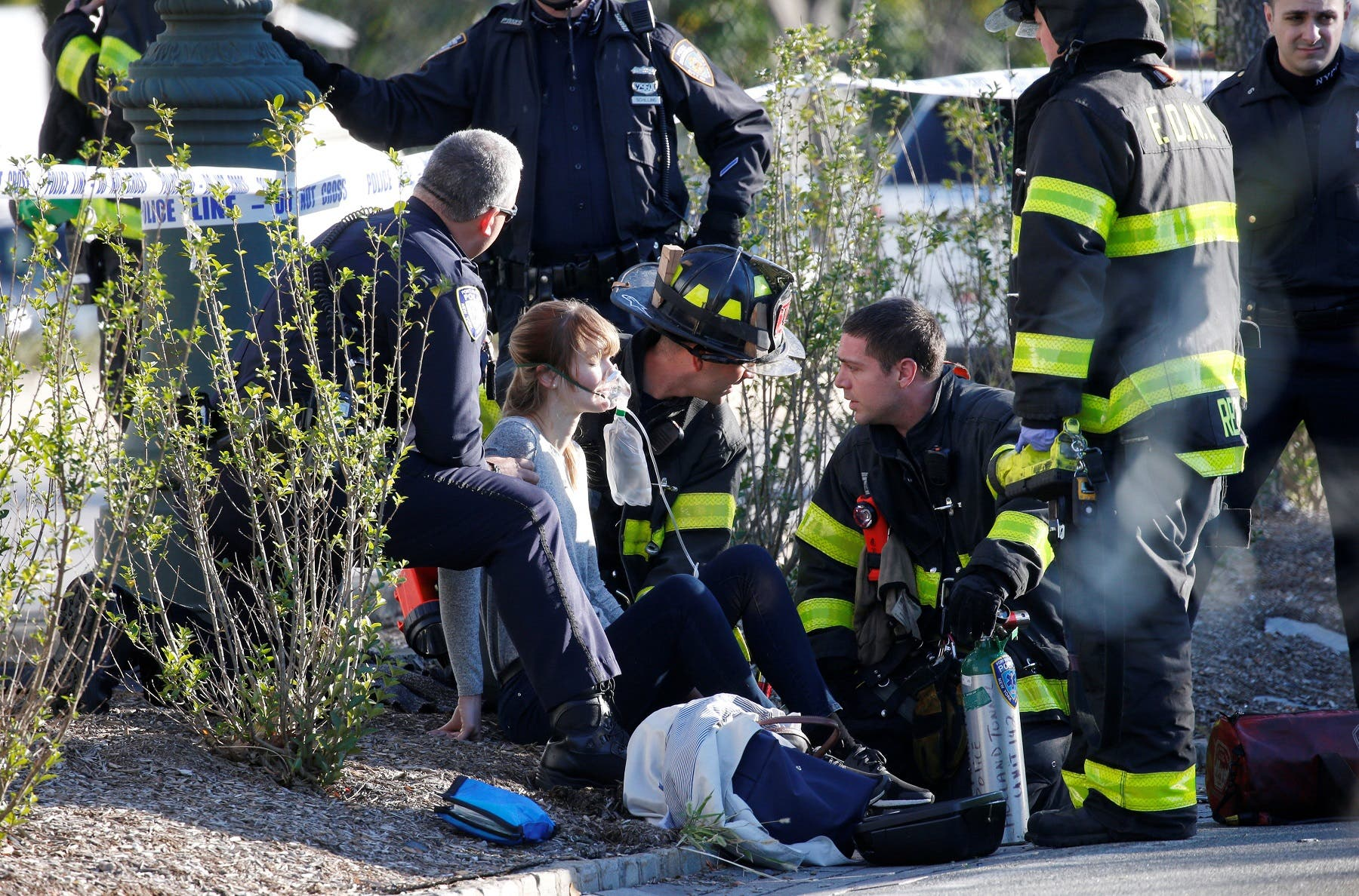 A woman is aided by first responders after sustaining injury on a bike path in lower Manhattan in New York. (Reuters)