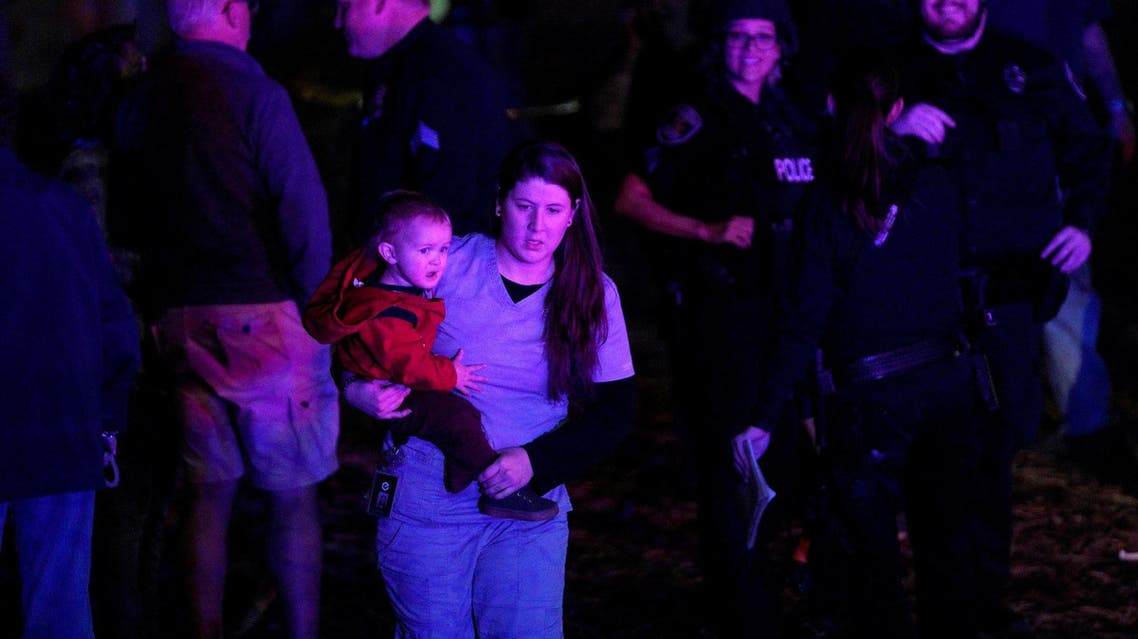 A woman with her child during the shooting in Thornton, Colorado November 1, 2017. (Reuters)
