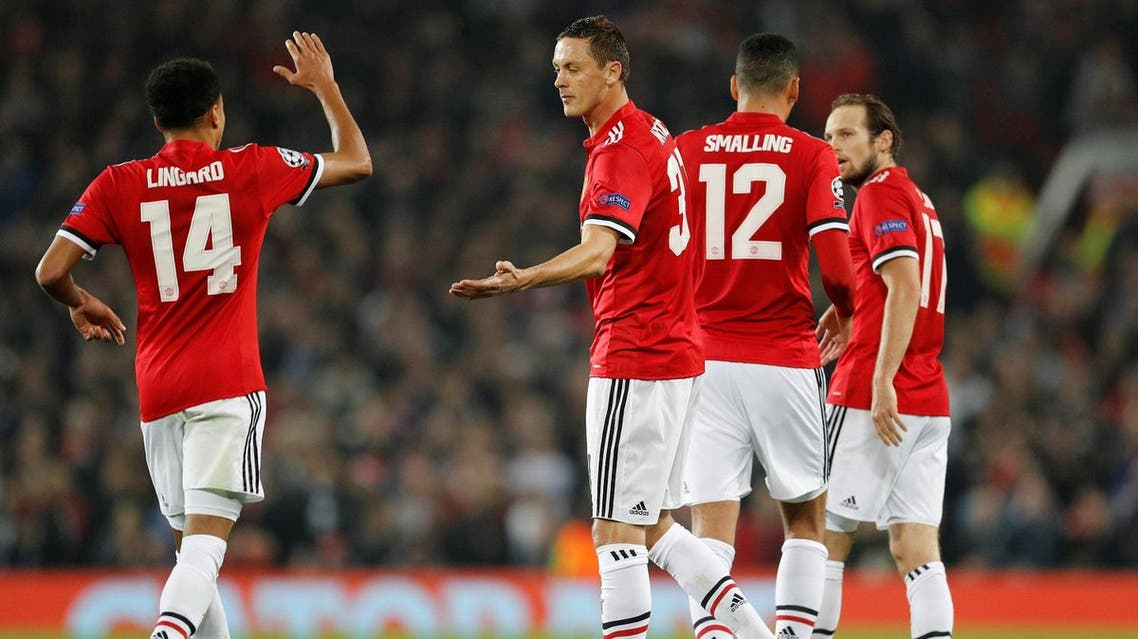 Manchester United's Nemanja Matic celebrates with Jesse Lingard after the first  goal, an own goal scored by Benfica's Mile Svilar (not pictured) on October 31, 2017. (Reuters)