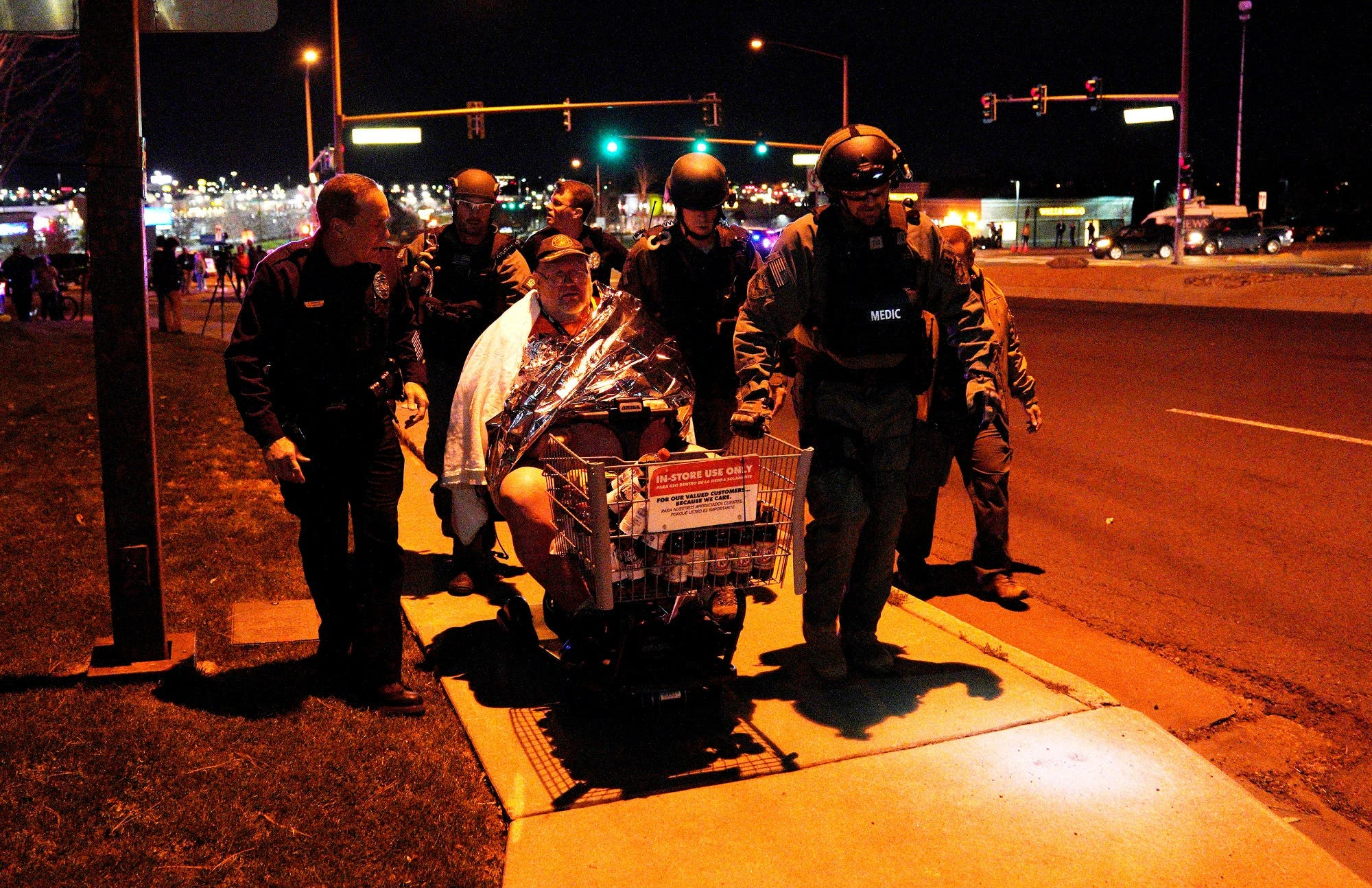 A man is evacuated in a Walmart cart by SWAT medics from the scene of shooting in Thornton, Colorado November 1, 2017. (Reuters)