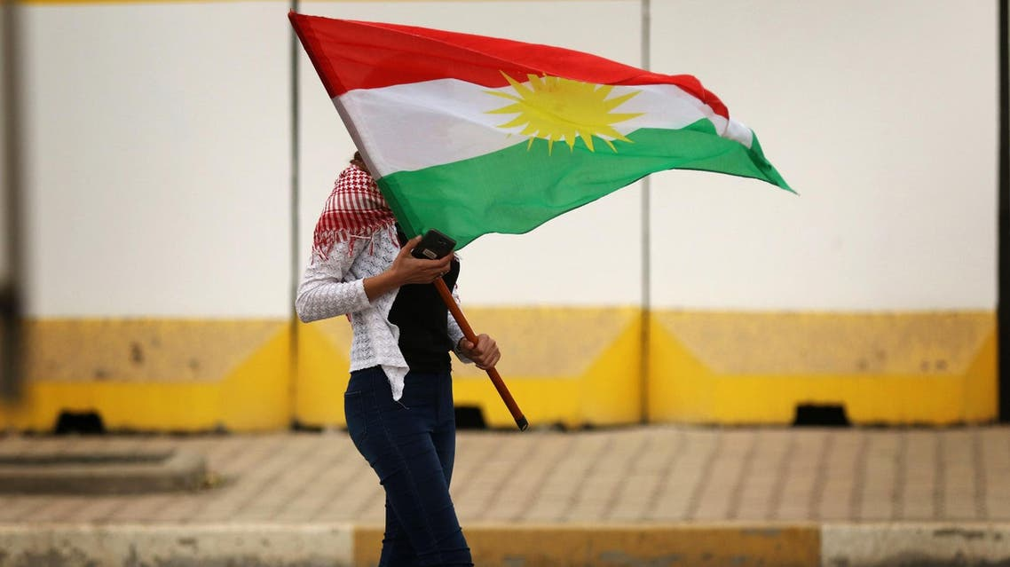 An Iraqi Kurd marches with a Kurdish flag during a protest in support of the Iraqi Kurdish leader, in Erbil, on October 30, 2017. (AFP)