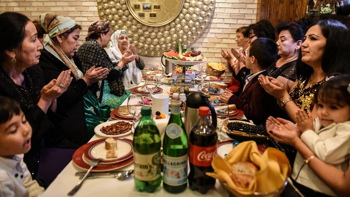 People pray before the start of a meal at an Uzbek restaurant in Brooklyn borough on November 1, 2017. (Reuters)
