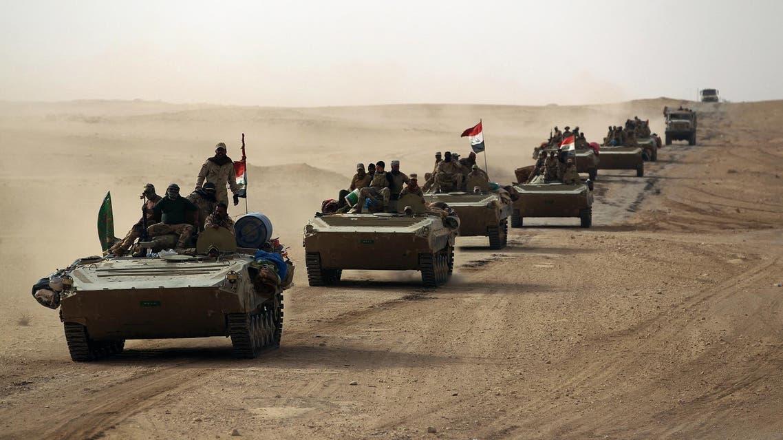 Iraqi forces and members of the Popular Mobilisation units advance toward al-Qaim on November 2, 2017. (AFP)
