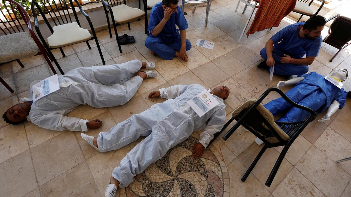 Syrian medical staff take part in a training exercise to learn how to treat victims of chemical attacks in Gaziantep, Turkey, on July 20, 2017. (Reuters)