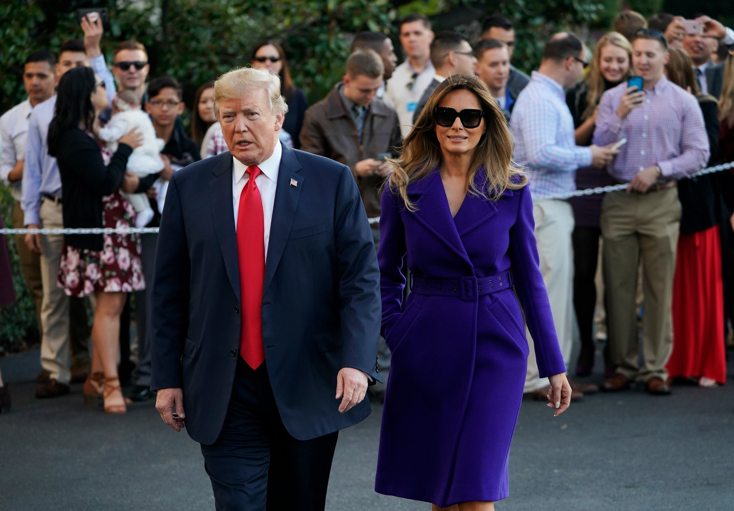 US President Donald Trump and First Lady Melania Trump walk towards reporters before departing from the South Lawn of the White House. (AFP)