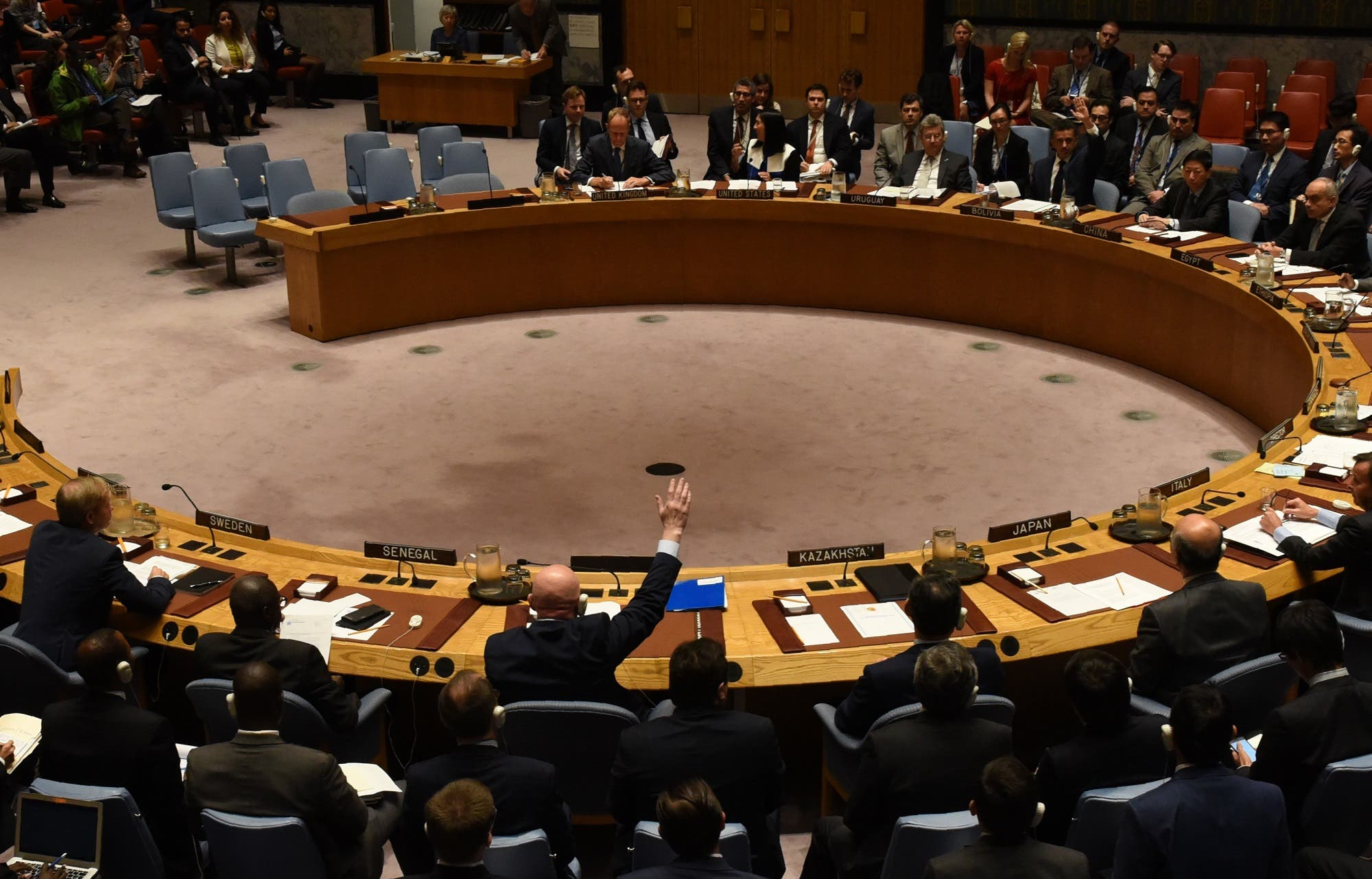 Security Council votes to extend probe into who is responsible for chemical weapons attacks in Syria at the UN on October 24, 2017. Russian Ambassador to the UN Vassily Nebenzia (raising his hand) voted no to the resolution. (AFP)