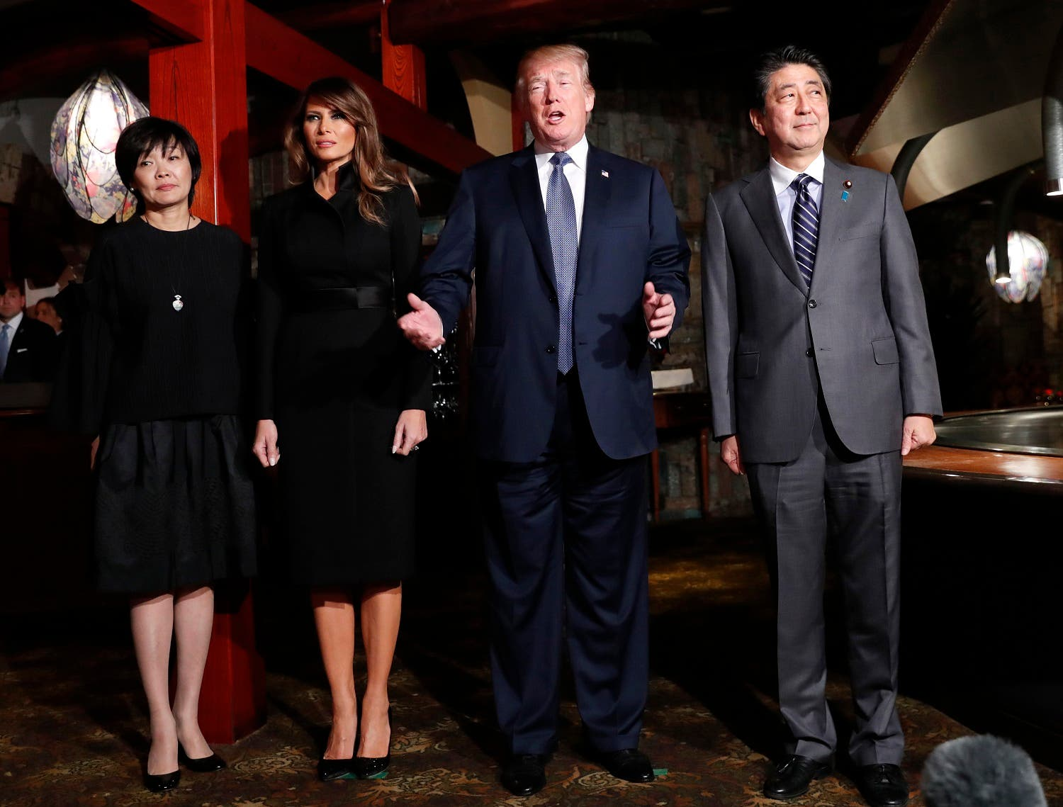 President Donald Trump, accompanied by first lady Melania Trump, , Japanese Prime Minister Shinzo Abe and his wife Akie Abe, speaks to members of the media before having a dinner at Ginza Ukai Tei restaurant, on Nov. 5, 2017, in Tokyo. (AP)