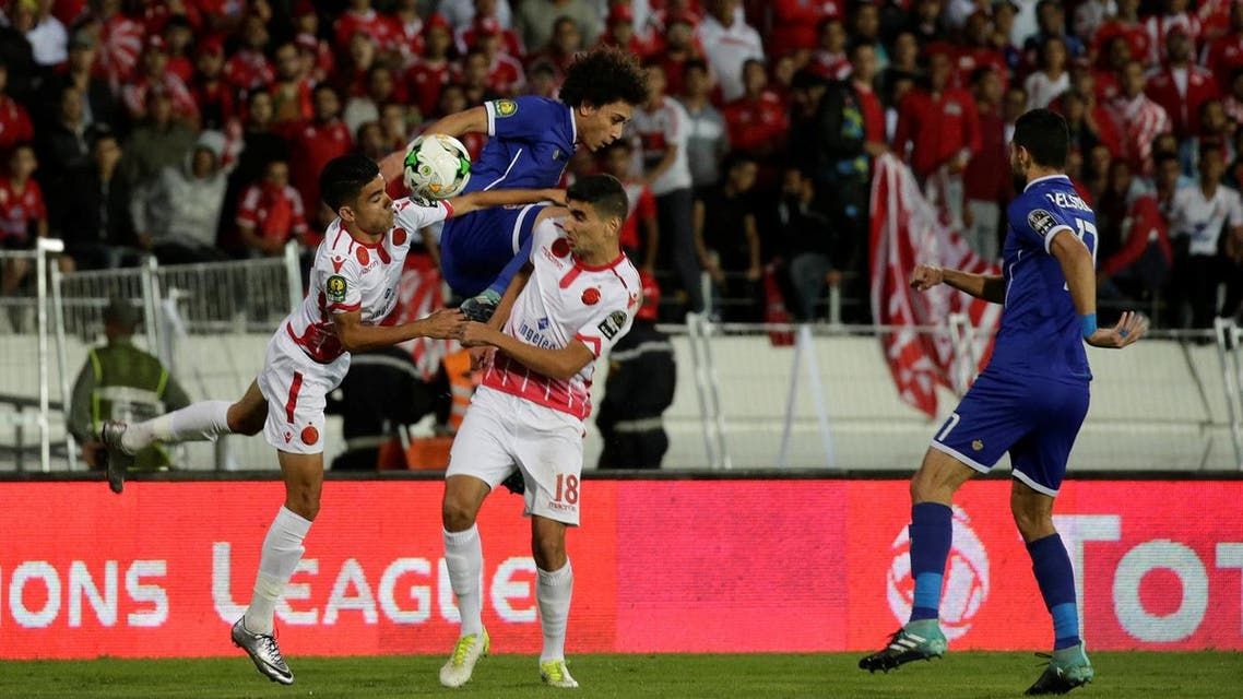 Al Ahly's Hussein Sayed in action with Wydad's Walid El Karti (Reuters)