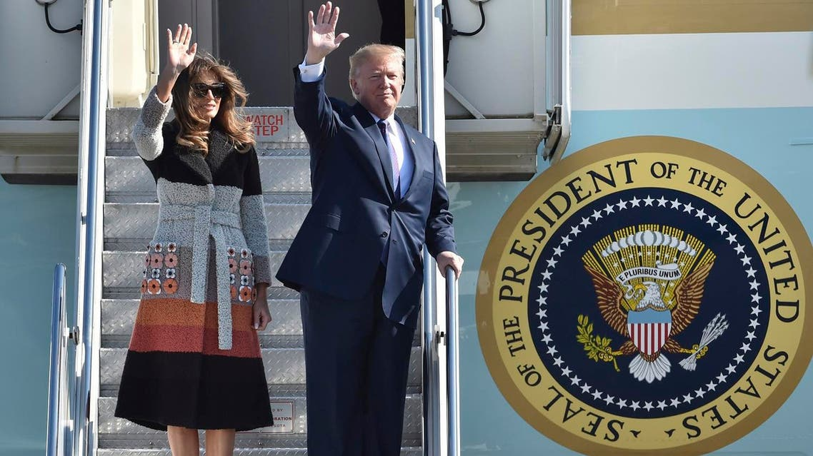US  President Donald Trump and first lady Melania Trump wave on their arrival at the US Yokota Air Base, on the outskirts of Tokyo, Sunday, Nov. 5, 2017. (AP)