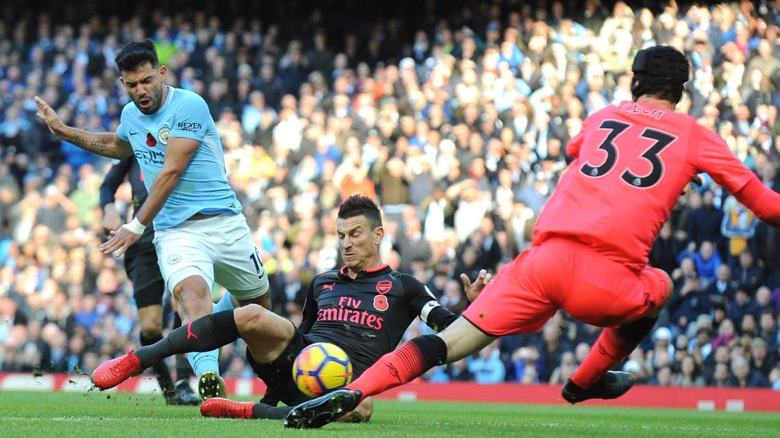 Manchester City's Sergio Aguero (left), shoots the ball during the English Premier League soccer match between Manchester City and Arsenal on Sunday, Nov. 5, 2017. (AP)