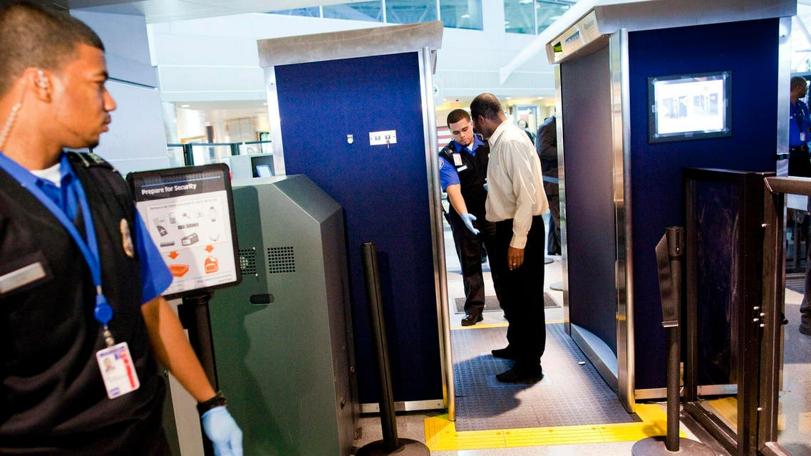 TSA officers give a demonstration of the first Advanced Imaging Technology unit at John F. Kennedy International Airport's Terminal 8 on October 22, 2010. (Michael Nagle/Getty Images/AFP)