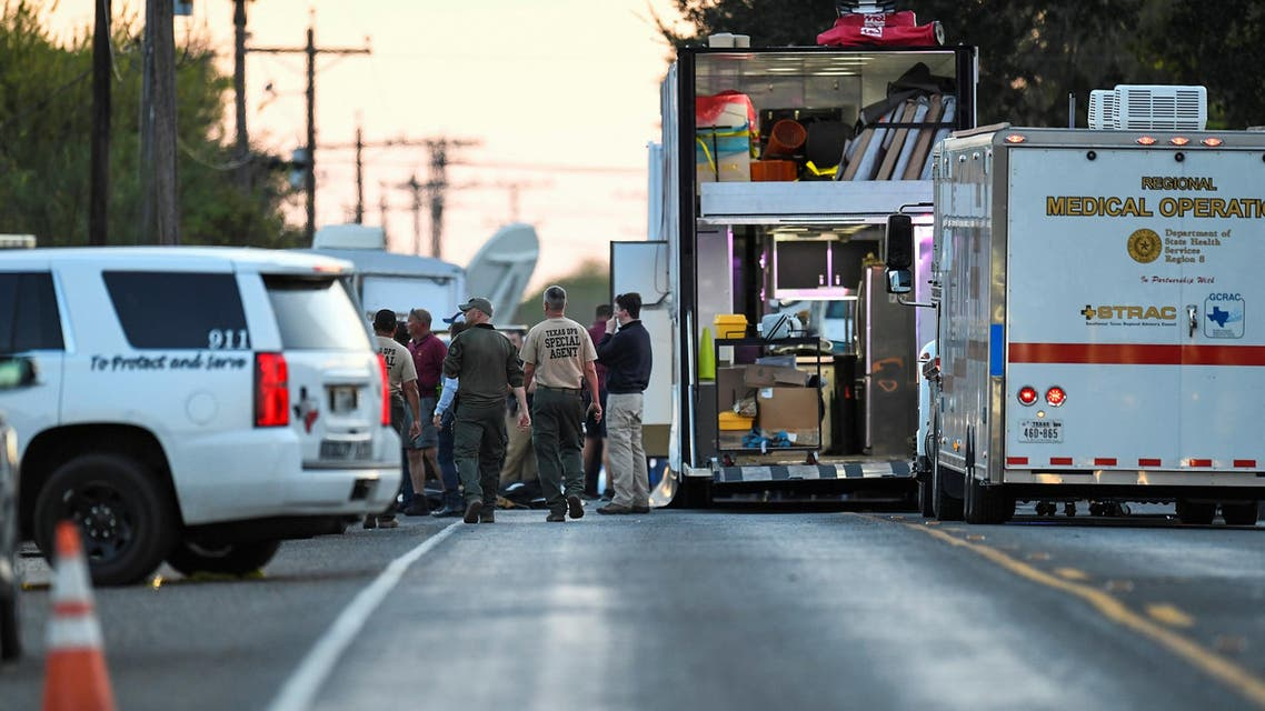 Medical personnel and law enforcement set up along a street near the First Baptist Church in Sutherland. (Reuters)