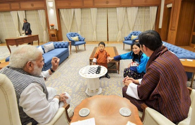 The toddler admires his chess set as his father and Modi discuss matters of state. (Supplied)