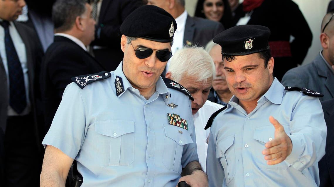 Palestinian police commander in the West Bank, Hazem Atallah (L), arrives at the Independence University, a security academy that trains police and security forces officers, to attend the inauguration ceremony of a mosque and a new part of the campus on May 1, 2015 in the town of Jericho. AFP PHOTO / AHMAD GHARABLI  AHMAD GHARABLI / AFP